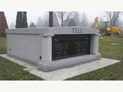 Side-by-side gray granite mausoleum with columns on a slab in Plainfield, IL