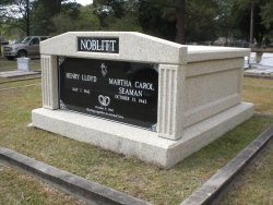 Side-by-side deluxe white mausoleum with fluted columns in Pascagoula, MS