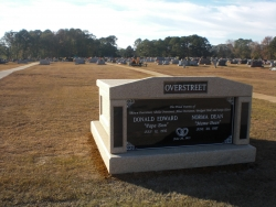 Deluxe side-by-side white mausoleum with engraved granite inlays in the columns in Kosciusko, MS