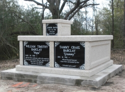 Side-by-side basic mausoleum with an infant mausoleum attached on top on a foundation/slab in Magnolia, MS
