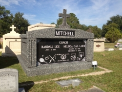 Side-by-Side deluxe FORTRESS mausoleum with a cross and with deep gray stone in Pascagoula, Mississippi