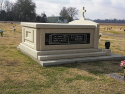 This is the side panel on the left side of the side-by-side deluxe mausoleum with cross and granite in the columns, vases on pedestals, engraved wide panels and step-up trim pieces on a foundation/slab in Clarksdale, MS