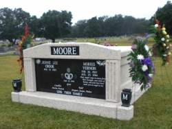 Side-by-side deluxe mausoleum with fluted columns and vases on pedestals in Oak Grove, LA