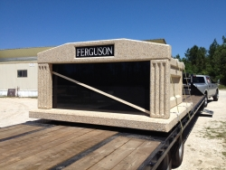 Side-by-side deluxe white mausoleum with fluted columns on a trailer getting ready to be shipped to Leona, TX